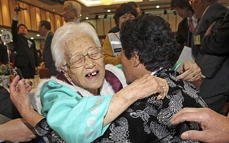 Divided family members hugging each other at a past North & South Korean reunion.